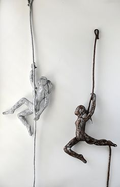 Metal sculpture Climbing woman with a rope rock climber by nuntchi