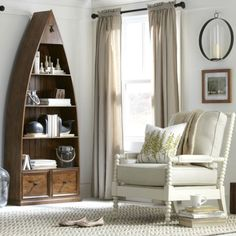 Boat shelf by Birch Lane: http://www.completely-coastal.com/2016/03/coastal-decor-birch-lane.html Self standing tall boat shelf in the living room.