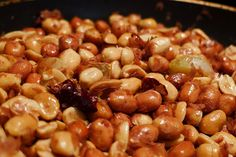Rick Bayless' Oaxacan-Style Peanuts with Chile and Garlic.  I add a bit of lime juice.  Rave reviews!!
