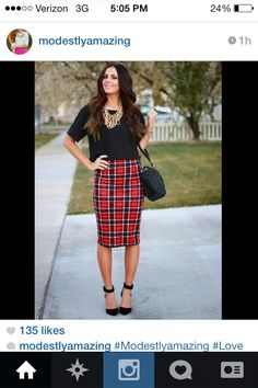 Plaid skirt, black top. Modest winter fashion