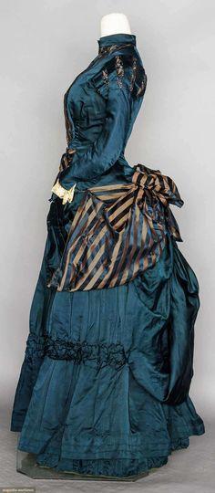 1881 1-piece navy silk satin, bodice & bustle skirt trimmed w/ navy & copper striped ribbon