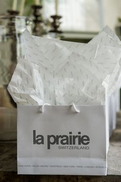Gift bags from La Prairie Timeless Beauty, Gift Bags, Bubbles, Gifts, Beautiful, Presents, Ageless Beauty, Goody Bags, Treat Bags