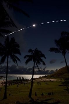 Eclipse on the Beach    Credit & Copyright: Guillaume Blanchard    As the New Moon's shadow slid across the southern Pacific on July 11, people gathered along the white, sandy Anakena Beach on the north side of Easter Island to watch a total solar eclipse. The experience was captured in this tantalizing composite image, constructed from a sequence of 50 consecutive exposures. At their center is the totally eclipsed Sun surrounded by a shimmering solar corona.
