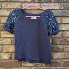 **BOGO** Sequined sleeved blue shirt Selling a blue top with sequined sleeves. Great condition! H&M Tops