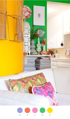 love the bright colors on the walls and pillows. great color combination—makes me want to go to the beach!