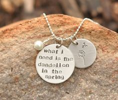 "Hunger Games Jewelry hand stamped necklace stamped with ""What I need is the dandelion in the spring"" $16"