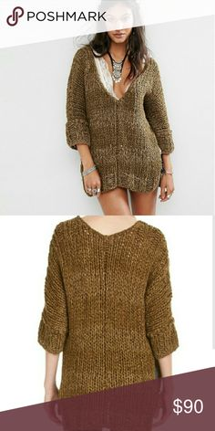 Free People V neck sweater In a comfy and oversized shape this plunging V-neck sweater features three-quarter length sleeves and exaggerated side vents. Super soft and marled fabric.  65% Cotton 31% Acrylic 4% Nylon Olive Color Free People Sweaters