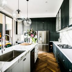 Darren and Dee's shaker style classic kitchen. Love the parquet floor