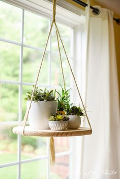 All it takes to make one of these shelves is some yarn, scissors, and a wooden plate from your local hardware store.
