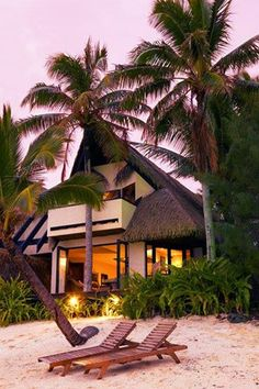 Looking back at a beautiful beach front villa from the beach at Rumours Luxury Villas  Spa - Rarotonga
