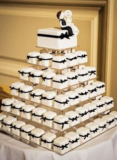 I've seen cupcake cakes but never a cake made of mini cakes. I just fell in love with this idea. Each layer of mini cakes could be different or each could have a different accent. Wedding Cupcakes, Wedding Desserts, Wedding Decorations, Mini Desserts, Cheesecake Wedding Cake, Wedding Cake Boxes, Fancy Wedding Cakes, Square Wedding Cakes, Cheesecake Brownies