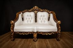 Antique white royal seat with ornaments
