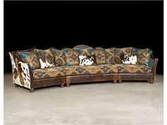 I'm really not into the whole 'western wear' look, but this is pretty freaking awesome.   Paul Robert Tomlyn Sectional