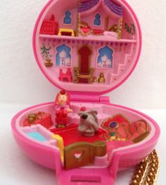 Polly Pocket: Any girl of the '90s loved Polly Pockets. So give her a vintage (circa 1992) jeweled palace ($14) one! I had so many of these growing up.