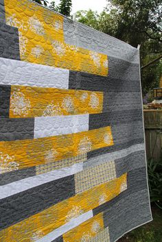 I can dig it! The first quilt I actually like, not mention this a more modern look. ;-)  Yellow + greys, strips