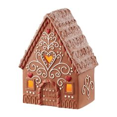 Item Number: 4051891 Materials: Glitter, Claydough Dimensions: 5.35 in H x 3.58 in W x 7.2 in L This porcelain gingerbread house serves as a picture-perfect backdrop for the Sweet Memories collection.