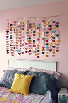 Oh, the waterfall of hearts... I love many things about this room, but this is one of my favorites.  It's so simple and dreamy.  It's perfect above her white headboard. The details on this: - pieces of scrapbook paper - fishing line - a branch - hot glue - a few nails to hang All together this cost a Total of $5!  Doesn't it look like it should be worth so much more?