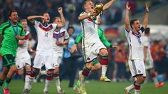 Bastian Schweinsteiger  of Germany celebrates with the World Cup trophy