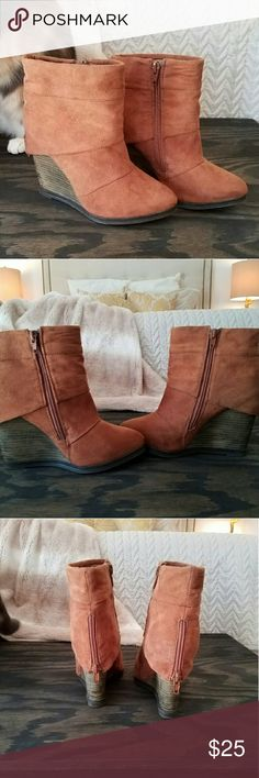 Brown wedge booties! Brown ankle wedge bootie with wooden heel and rubber sole. Zippers in inside and back of the boot. Worn a few times, minor scuffing on the toes. Super cute with skinny jeans! Shoes Ankle Boots & Booties