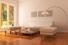 Minimalist modern living room with wood flooring and white furniture