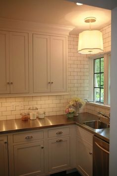 West End Cabinet Company - Butler's pantry with white kitchen cabinets, stainless steel bench tops and tiled backsplash
