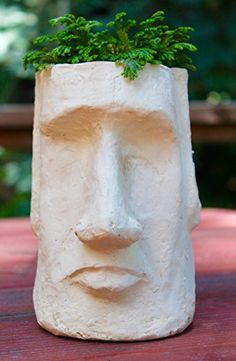 50 Unique Pots & Planters You Can Buy Right Now You don& have to journey to a far off island to experience exotic art. This Easter Island Head Planter brings it right to your tabletop. Face Planters, Planter Pots, Garden Planters, Pot Jardin, Sculptures Céramiques, Sculpture Clay, Exotic Art, Pot Plante, Self Watering Planter