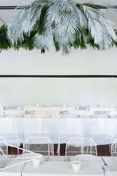 FOR THE RECEPTION || Contemporary all white seaside beach table settings with hanging palm floral installations || NOVELA BRIDE...where the modern romantics play & plan the most stylish weddings... www.novelabride.com @novelabride #jointheclique