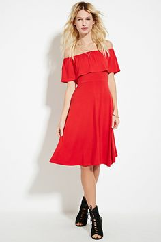 This knit dress features an elasticized neckline, a flounce-layered bodice, and off-the-shoulder short sleeves.