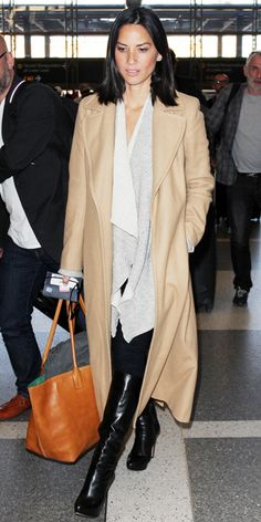 OLIVIA MUNN Munn figured it out—the key to comfort on an aircraft is layers. Top off a long shawl-style cardigan with a long flowy overcoat, which can double as a blanket.