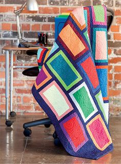 Bold solid colors make a big impact in this great throw. You can change the colors to match any décor. It's easy to make, too!