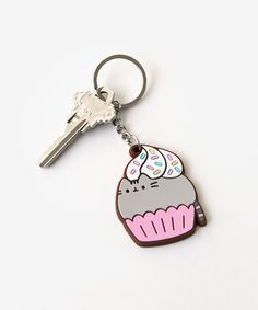This adorable keychain features Pusheen as a cupcake! PVC charm measures approximately and hangs from a key ring. Pusheen Love, Pusheen Shop, Pusheen Cat, Pusheen Stuff, Pusheen Stormy, Cute Office Supplies, Cat Keychain, Kawaii Room, All Things Cute