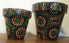 Macetas pintadas a mano. Facebook: A'cha Pots.