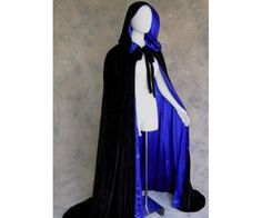 Im no fashion expert, but they should really bring back cloaks into style.This black and blue lined cloak is an a renaissance style and looks pretty cool.