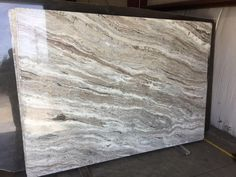 Brown Fantasy Quartzite. Nice waves of white, brown and grey tones for the vanity top.  This is the one!