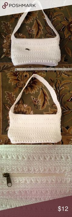 Croft & Barrow white crochet/knit small purse Small White crochet/knit purse.  3 pockets on the inside and 1 zipper pocket on the outside.  Inside is lined.  1 pinpoint spot on the inside of purse.  Like new condition. Croft & Barrow Bags