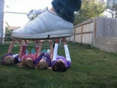Girls holding giant foot up #photography  #forcedprospective
