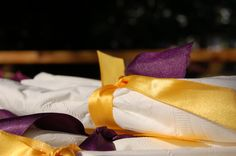 Napkins wrapped around cutlery (tied with a ribbon) for an easy grab after getting some food