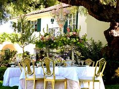 Gold chairs create a fantasy dining room outdoors!
