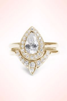 Pear Shaped Diamond Engagement Ring with Matching Side Diamond Band - The 3rd Eye. Engagement rings set See more here: https://www.etsy.com/listing/254963289/pear-shaped-diamond-engagement-ring-with?ref=shop_home_active_1