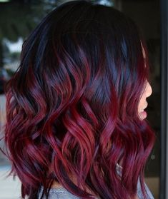 The '90s Mulled Wine color is back, and now we really want to dye our hair dark cherry red