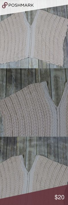 Flying Tomato Knit Lace Trim S/S Poncho Sweater Flying Tomato Women's Knit Lace Trim Short Sleeve Poncho Sweater.  Size small/medium.  Two toned- cream with pink overtones on the outside, solid cream in the middle.  100% cotton.  Machine wash.  In good, preowned condition with no flaws noted.  In good, preowned condition with no flaws noted.  Back of tag has writing on it.  From online:  Details - Allover lace makes up the body of this V-neck and back poncho. - Front and back V-neck with…