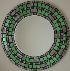 With Over 40 Original Desings in my collection , be sure to take a look. each mirror is also singed and dated on the back by myself , an original peace of artwork. This beautiful mirror has been all hand made by myself using highest quality materials, tiles and grout on the