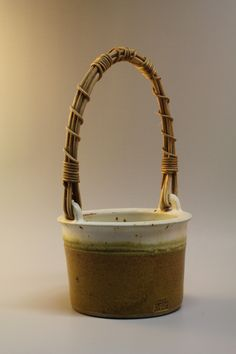 stoneware basket w reed handle