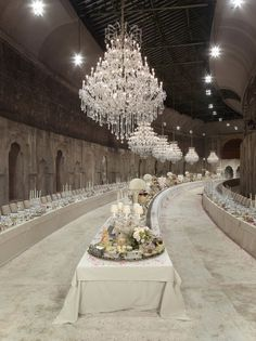 Chanel Métiers aD'Art Pre-Fall 2012 Paris-Bombay show. The Grand Palais was transformed into a Maharaja's palace complete with long tables set for high tea. Tables brimmed with fruit, floral arrangements and crystal candelabras.