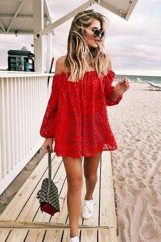 Red off the shoulder dress.