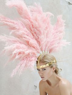 la la loving pink feathered and gold headdress.