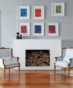 Esta lareira ganha um espírito moderno, com a coleção de aquarelas de Gonçalo Ivo. As esculturas de árvores são do mineiro José Bento.