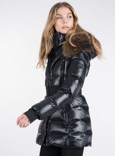Shell: 60% polyester, 40% nylon Lining: 100% nylon Fur trim: 100% natural raccoon, origin: Finland Down fill: 80% pure goose down, 20% down feathers Dry clean only