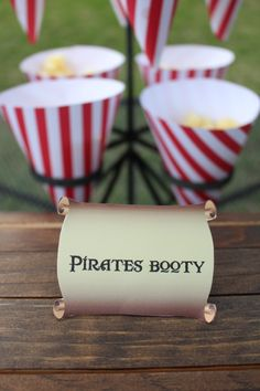 Pirates Booty displayed in red and white snack cones at a pirate theme birthday party...custom food labels