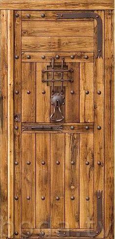 puertas rusticas de madera de roble macizo con forja autentica de fragua.